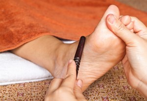 reflexology foot massage by stick wood, spa foot treatment,Thailand
